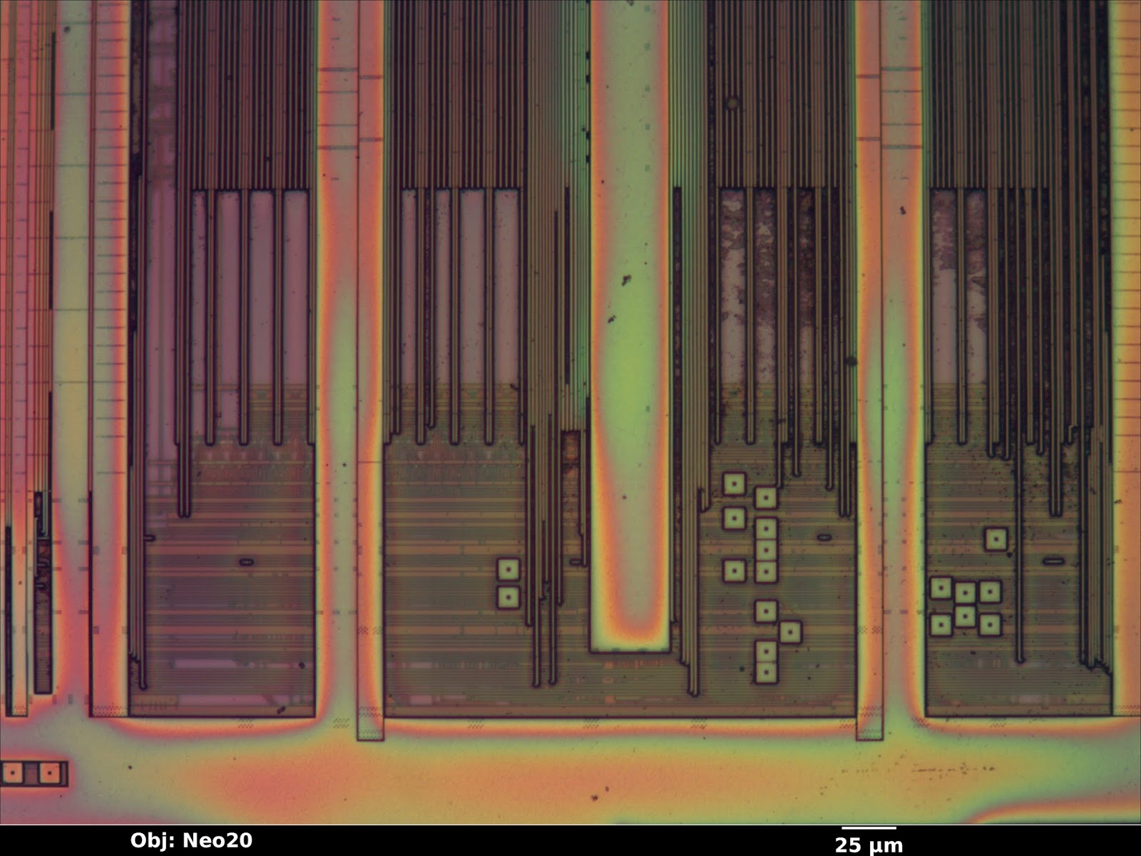 Inside The Ioactive Silicon Lab Interpreting Images Color Lights Organ Circuit Using Cmos Ics Thickness Of Top Passivation Layer Varies Significantly Across Die Surface Resulting In Rainbow Colored Fringes